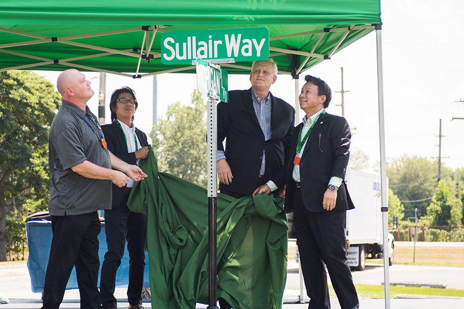 Sullair Way street sign unveiled at the Sullair-Hitachi one-year anniversary celebration